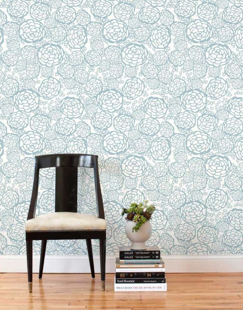 photo of white wallpaper with light blue floral line print and black chair