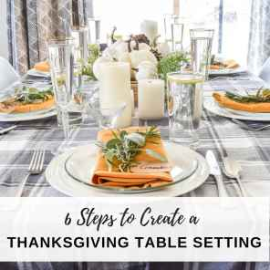 image of how to create a Thanksgiving table setting with mustard yellow napkins & place card holders with fresh herbs