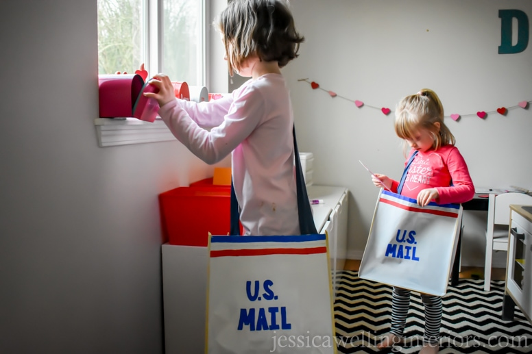 image of children delivering mail in play post office for Valentine's Day