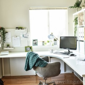 This Ikea home office makeover on a budget features the Kallax bookshelf as a room divider, a Linnmon table desk hack, a comfy chair, pegboards, and more!