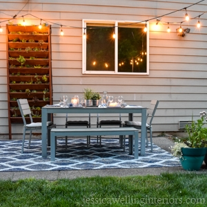 patio dining room with easy DIY string light poles and vertical garden