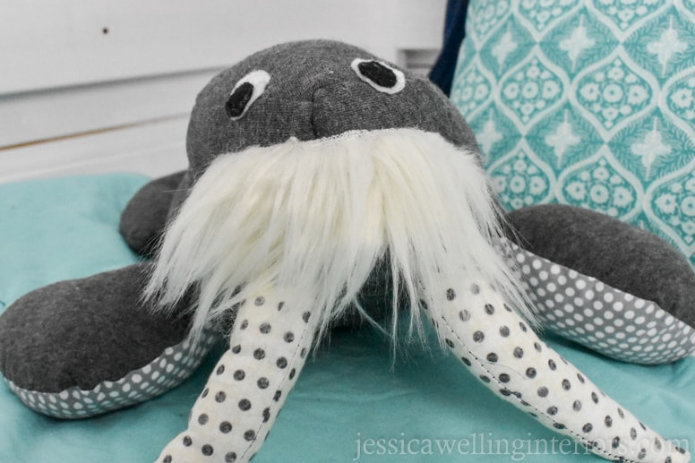 homemade stuffed warus with polka-dot tusks on a child's bunk bed