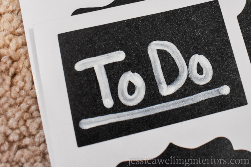 "chalkboard sticker label with the words. ""To Do"" written and underlined in white paint pen"