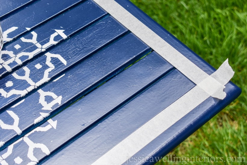 navy spray painted patio table with masking taped edges