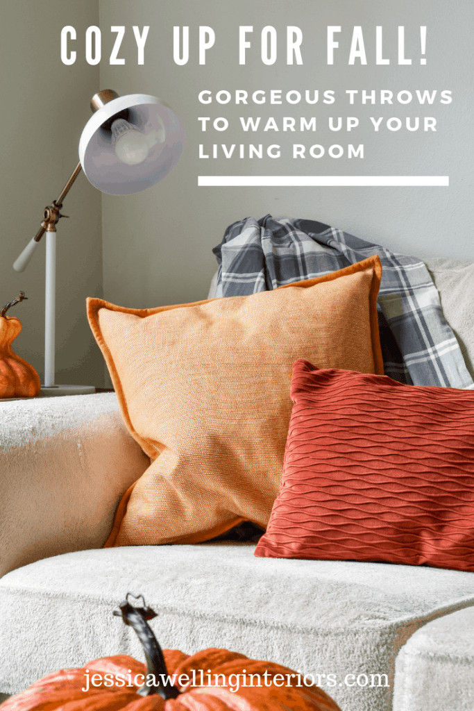 Cozy up for Fall! Gorgeous Throws to Warm up Your Living Room: Fall living room decor with cream colored sofa, grey plaid throw blanket, yellow pillow, and orange lumbar pillow