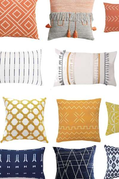 modern fall throw pillows in orange, yellow, navy, and white on a white background