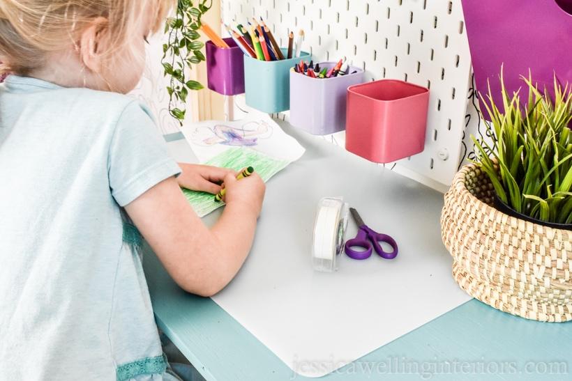 little girl working at floating kids desk