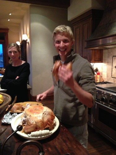 Packer carving the turkey at one of our team Thanksgiving parties
