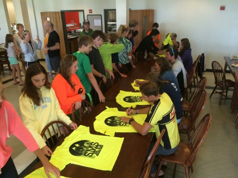 Signing the camp t-shirts on the last day! (photo by Pat)