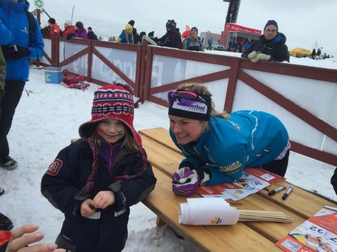 Signing posters at a snow kids event after the races.