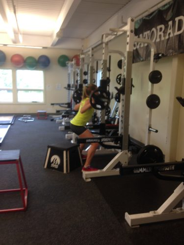 Erika working on her squats in the gym.