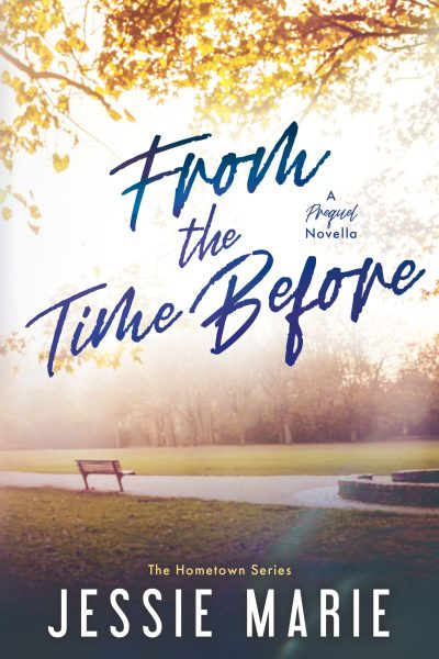 Book cover for FROM THE TIME BEFORE by Jessie Marie. The title is in the center-top of the book. The author name is at the bottom, in the center. There is a lone bench in a park, surrounded by grass and pavement. There are trees in the background.