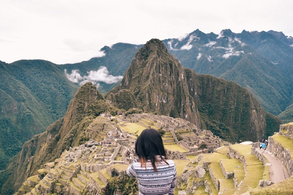 girl standing in front of Machu Picchu