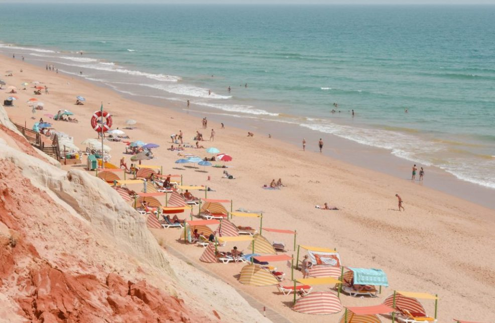 Colourful beach umbrellas at Falesia Beach in Albufeira Algarve Portugal
