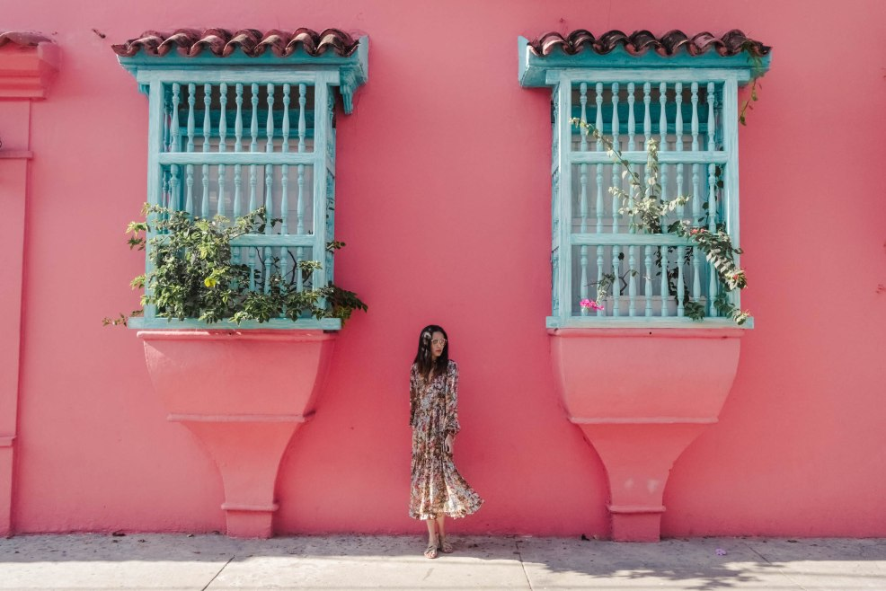 Pink house with blue windows in Cartagena