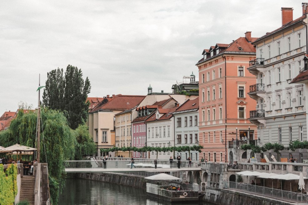 Colourful buildings along the river in downtown Ljubljana