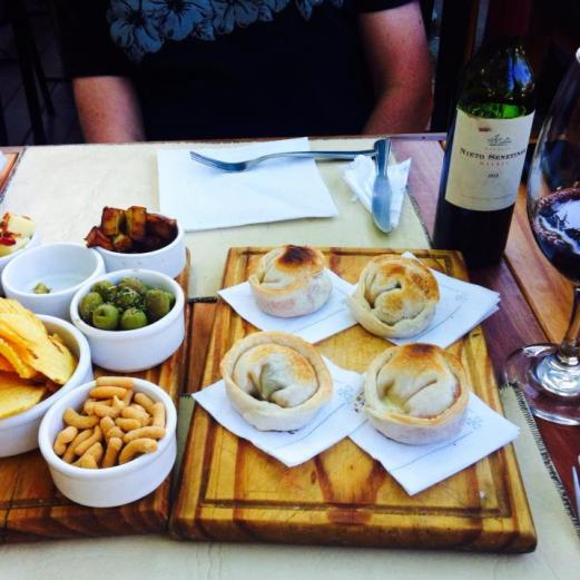 Empanada, snacks and malbec
