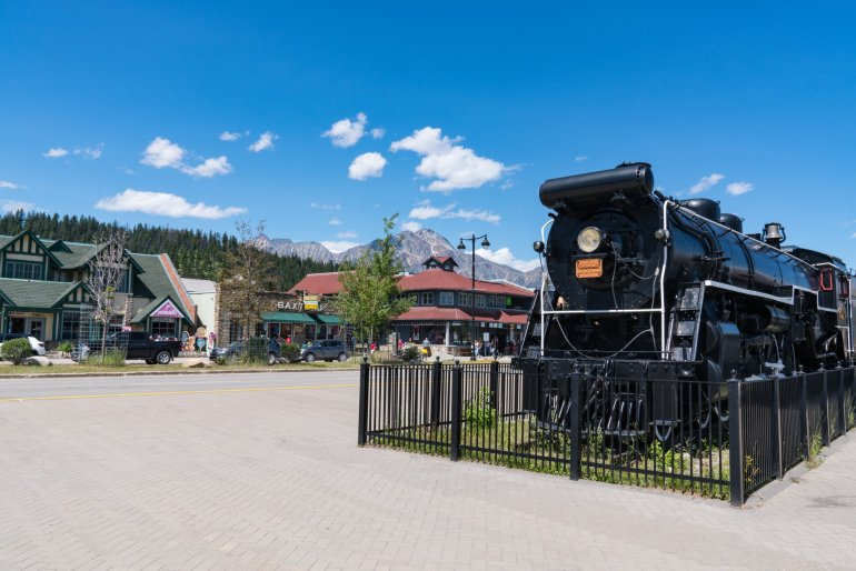 An old railroad train engine sitting on display in the town of Jasper.