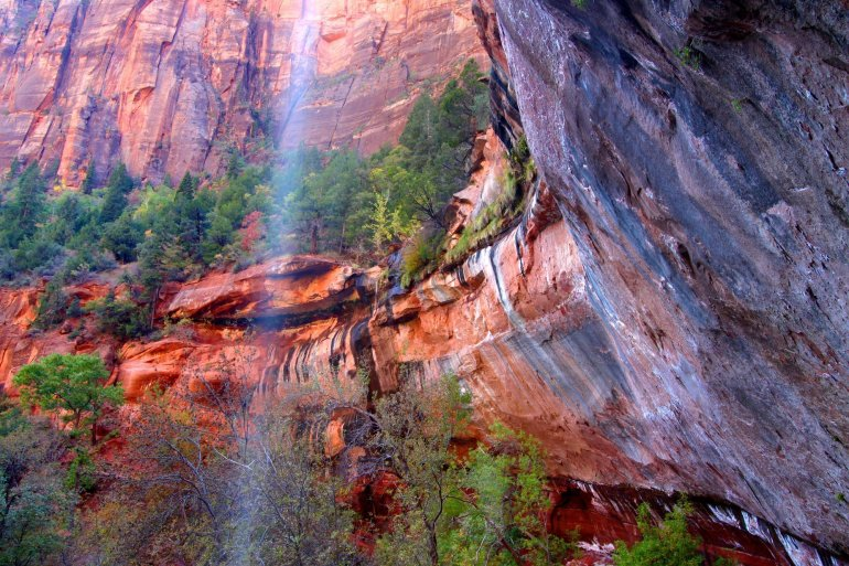 Waterfall flows into the Lower Emerald Pools of Zion National Park in Utah.
