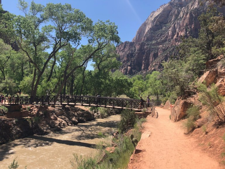 A simple bridge crossing a river at Zion National Park.