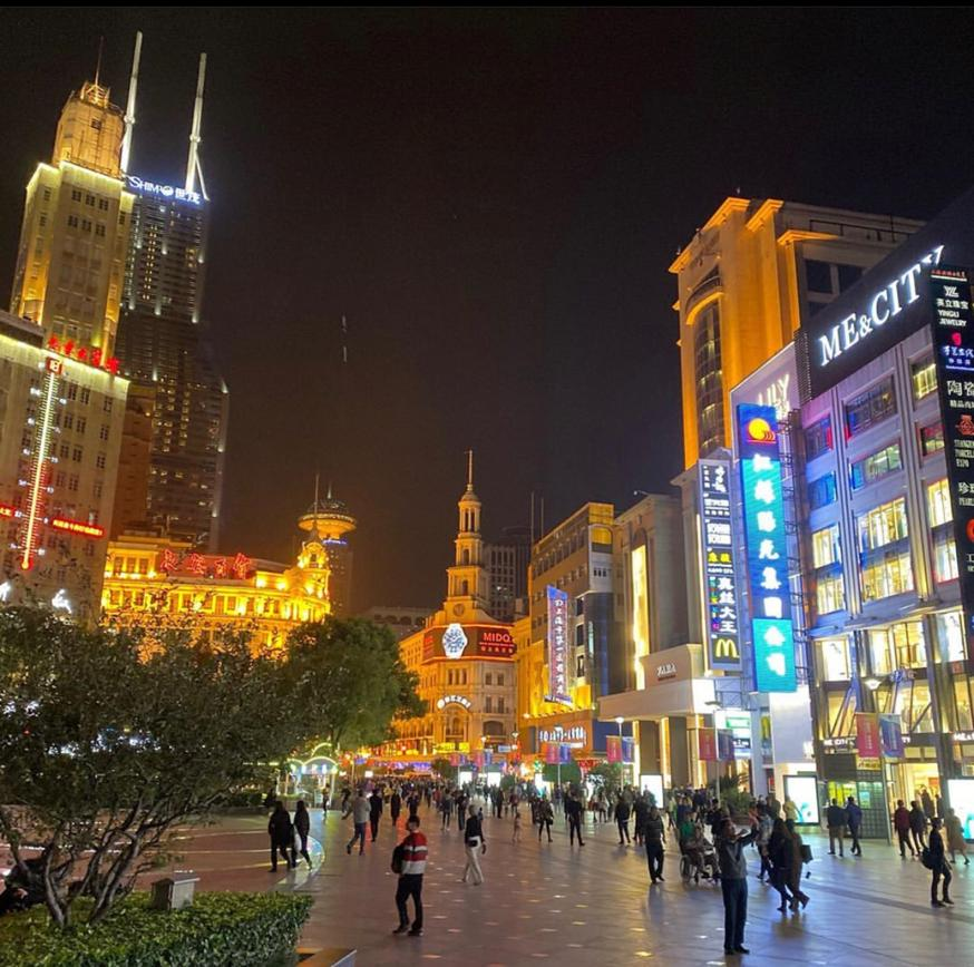 Shopping on Nanjing street with kids. Lit up at night