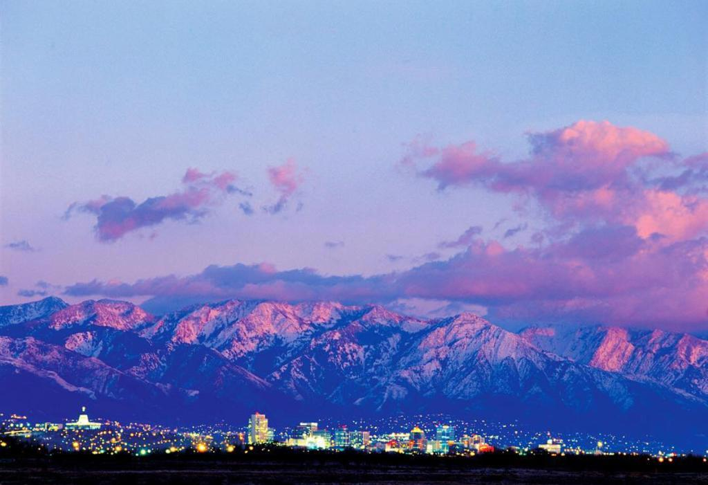 Salt Lake City at sunset with pink mountains in the distance