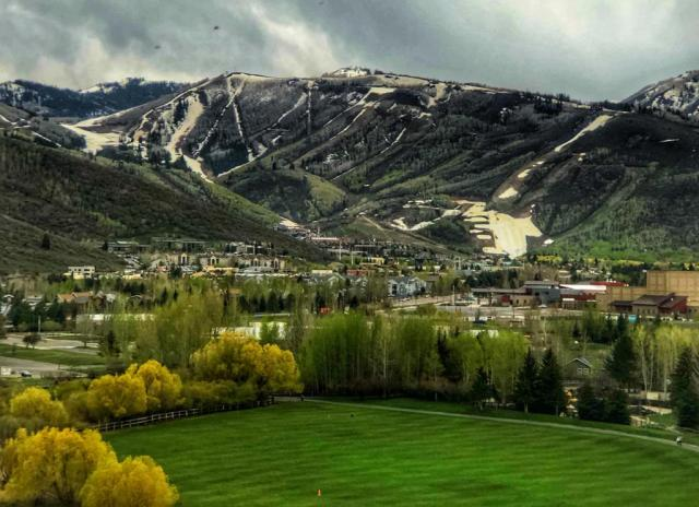 Views of Deer Valley Mountain with green hills and white snow