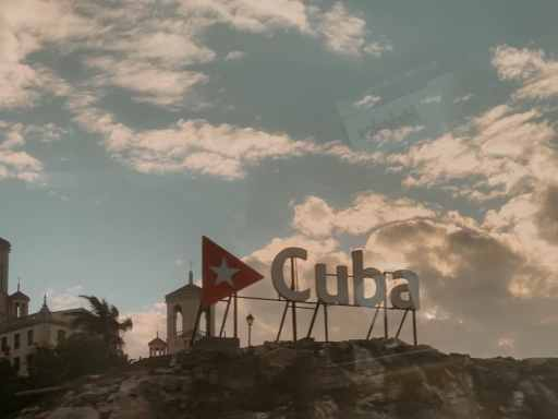 sign that says Cuba outside of the Hotel Nacional