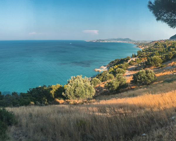 picture of the coast line from a mountain at Taverna Xigia. One of the top things to do in Zakynthos especially for a view.