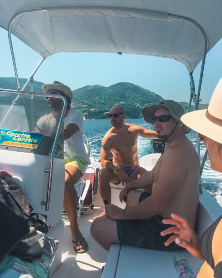 picture of me and friends on a boat in Zakynthos. Riding a boat around the Keri Caves is one of the top things to do in Zakynthos.
