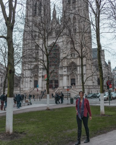 Me standing in front of The Cathedral of St. Micheal and St. Gudula one of the must-see places during a layover in Brussels