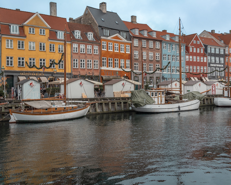 Picture of the painted houses along the Nyhavn canal the must place to see for your one day in Copenhagen.