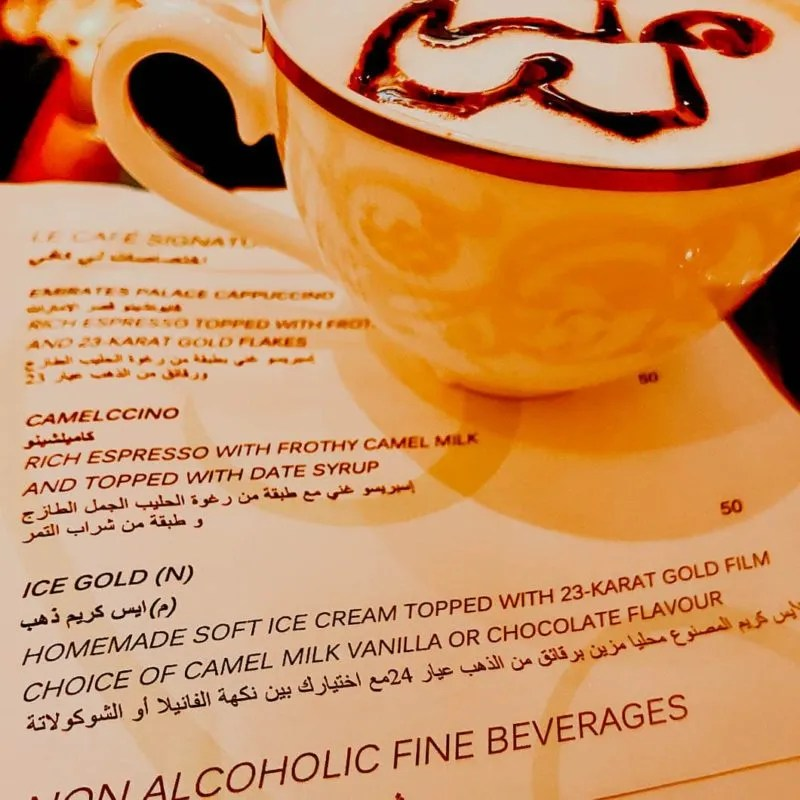 picture of the menu and a camelccino at Emirate's Palace I had during my Abu Dhabi day trip from Dubai