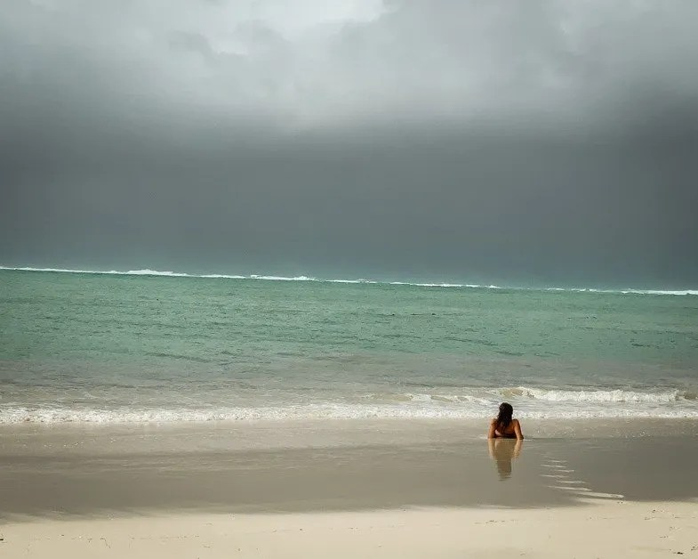 Me lying on a beach in Mauritius a top solo female travel destination