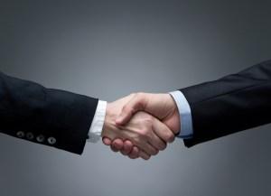 Man and woman business handshake