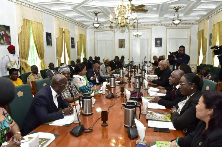 President David Granger (fifth, right) pays keen attention as President of Ghana, Nana Addo Dankwa Akufo-Addo (fifth, left) introduces the members of his delegation during a meeting at State House. (Ministry of the Presidency photo)