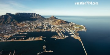 Aerial view of Victoria & Alfred Waterfront and Cape Town Harbour. Commercial docks and jetty on the sea.