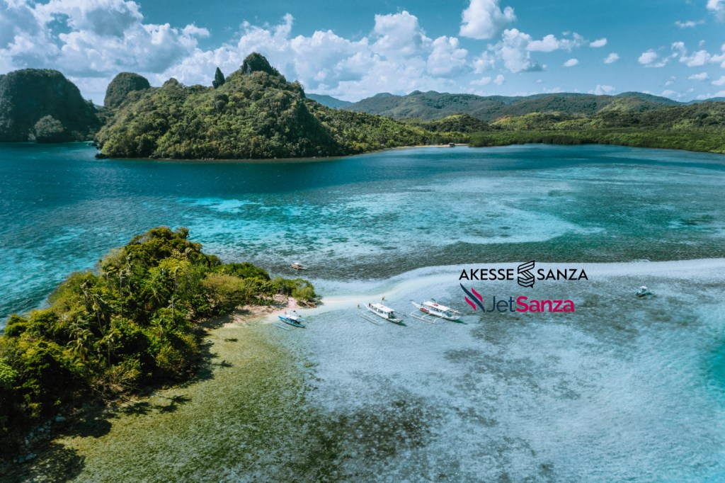 Aerial view of turquoise water and sandbar on tropical Vigan Snake Island, tourist attractions, tour trip El Nido Marine Reserve Park, Philippines