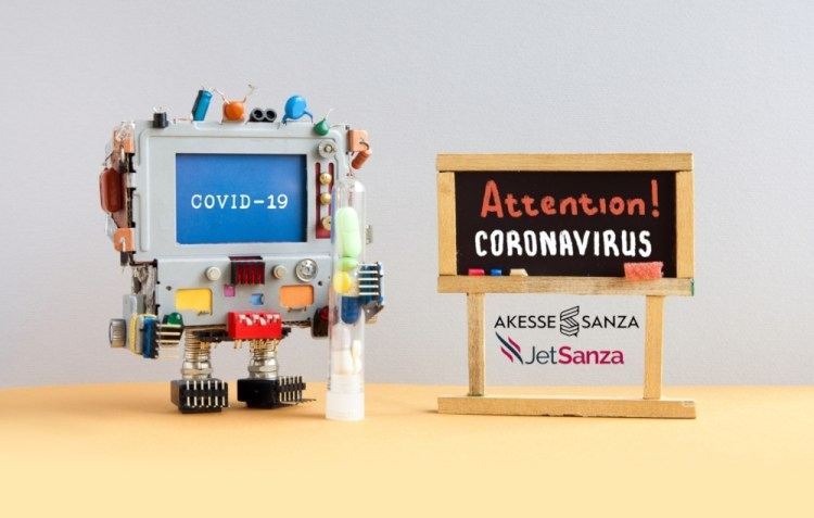 Attention coronavirus covid 19. A robotic research computer doctor holds a test tube with drugs and pills. Black chalkboard with the handwritten words warning of an epidemiological virus threat