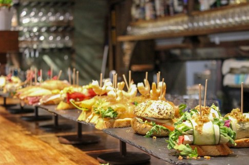 Bar full of pintxos in San Sebastian, Spain