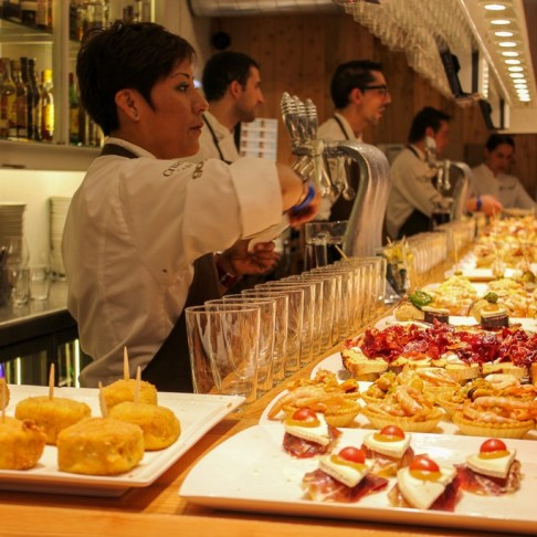 Platters of pintxos at San Sebastian tapas bar in San Sebastian, Spain