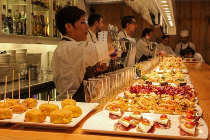 Platters of pintxos at San Sebastian tapas bar in San Sebastian, Spain