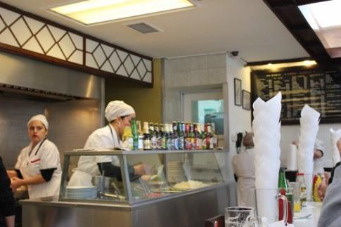 Women preparing sandwiches at the famous Fuente Alemana in Santiago, Chile