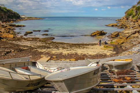 Boats on shore at Gordons Bay on the Bondi to Coogee coastal trek in Sydney, Australia