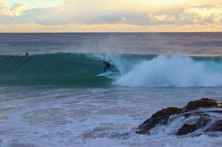 Surfer rides barrel wave at Snapper Rocks in Coolangatta, Gold Coast, Australia
