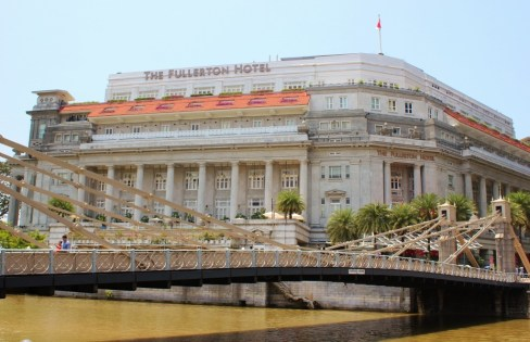 Historic Cavenagh Bridge and Fullerton Hotel in downtown Singapore