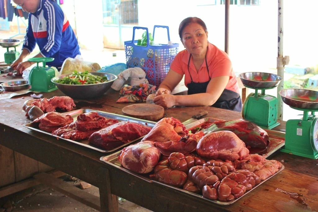 Long days for this woman ~ she butchers a cow, sells it at the market and then works at a bar at night