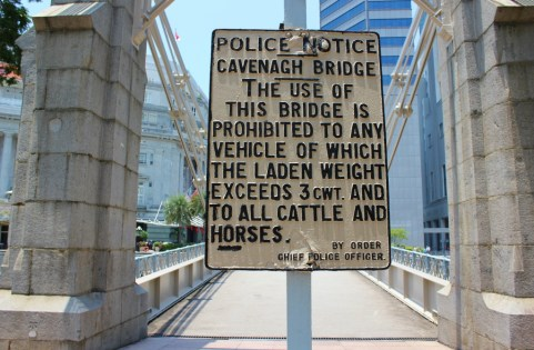 Cavenagh Bridge Police Notice sign in Singapore