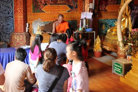 Monk gives blessings to children at Doi Suthep Temple in Chiang Mai, Thailand