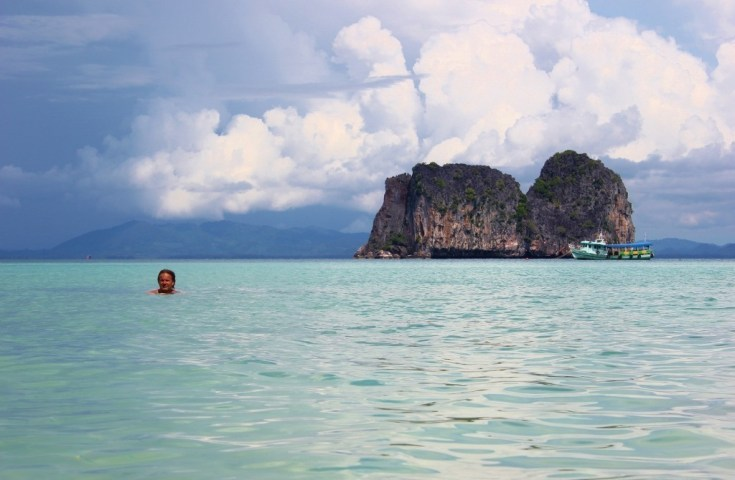 Swimming in the Andaman Sea on snorkeling trip from Koh Lanta, Thailand